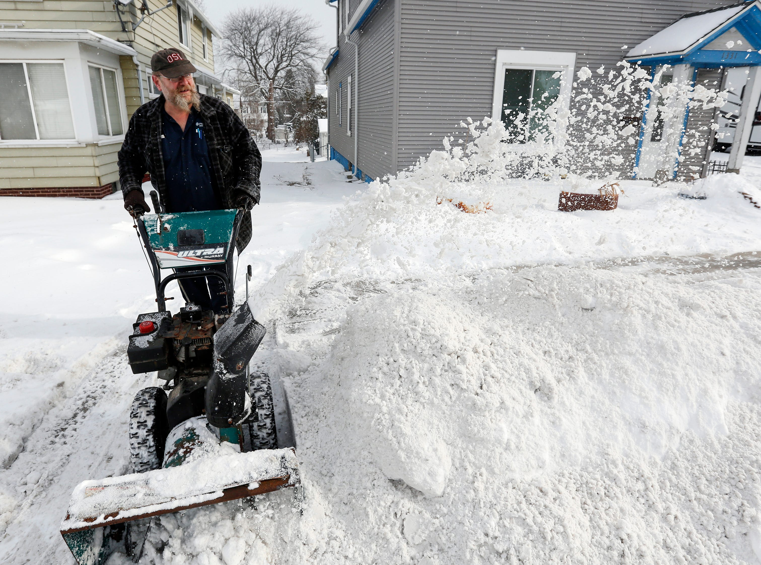 Jeff Pagels, of Manitowoc, clears his driveway after a snowstorm Wednesday, January 23, 2019, in Manitowoc, Wis. Joshua Clark/USA TODAY NETWORK-Wisconsin