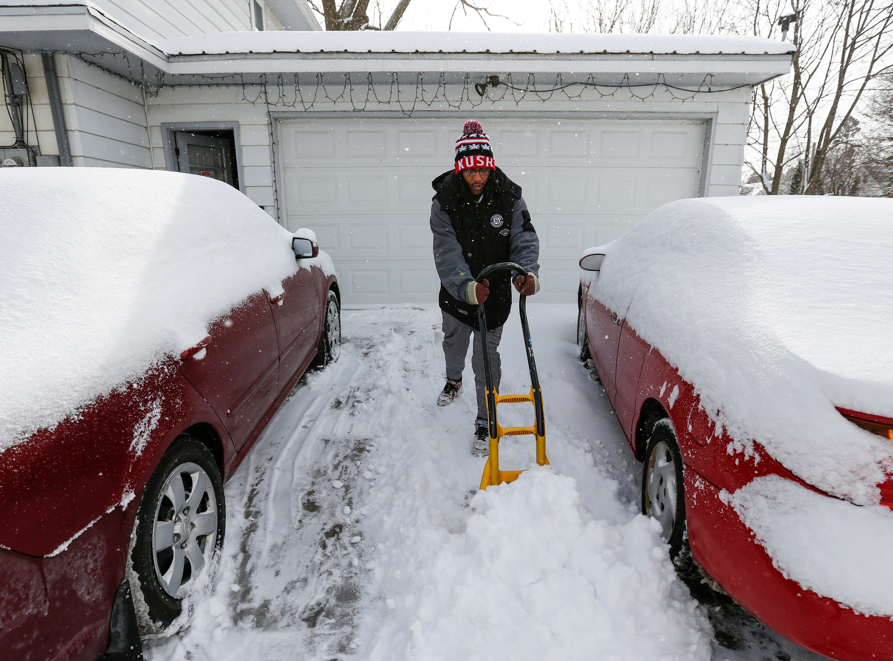 Brandon McCloud, of Manitowoc, shovels his driveway after a snowstorm Wednesday, January 23, 2019, in Manitowoc, Wis. Joshua Clark/USA TODAY NETWORK-Wisconsin