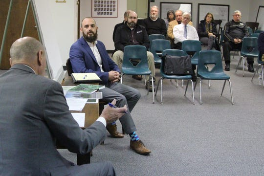 Jason Crawford, with Crown Enterprises, Inc., testifies in front of Marion Township Trustees on Tuesday. A special hearing was called to discuss the possible demolition of an abandoned truck depot on West Fairground Street, which has been vacant for decades.