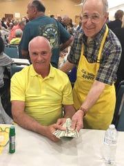 Gary Dzendzel, with Bingo committee member Jerry Levin, was the big winner at Monday Night Bingo.