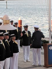 Outgoing Commodore Bob Winterhalter, right, administers the oath to incoming Commodore Jeff Comeaux as part of the change of watch ceremony at the Marco Island Yacht Club. Past Commodores and members of the 2019 Bridge participated in the event.