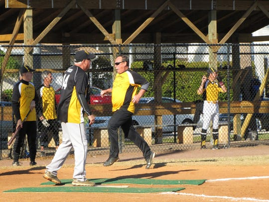 Tom Tankersley sprints home scoring a run for Nacho Mama's versus DaVinci's.
