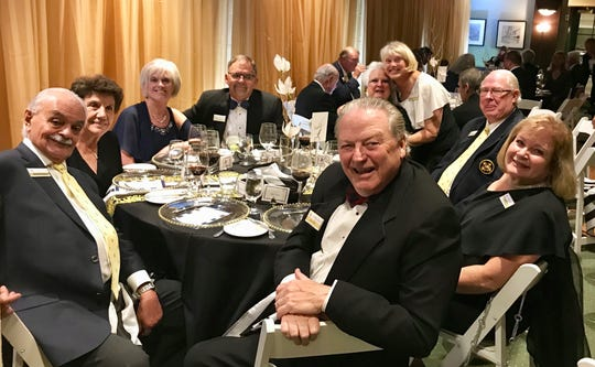 Marco Island Yacht Club members attending the Commodore's Ball enjoyed a gourmet meal prepared by Executive Chef Bob Aylwin and later danced to the music of the Classics II.  Pictured clockwise from the left, Dick and Grace Pantano, Kathy and David Caruso, Sandy Wallen, Margot Roberts, Bill Wallen and Angela and Jon Holt.