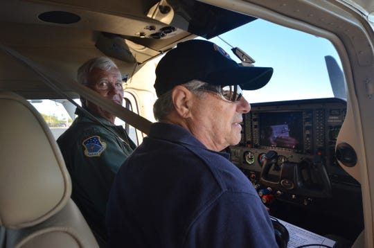 Marian Motyl-Szary, right, and Bob Boone prepare to take off on a search mission. Marco Island and Naples Civil Air Patrol squadron conducted a search and rescue exercise (SAREX) Saturday and Sunday, training for actual emergencies.
