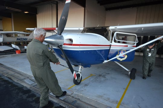 Marco CAP squadron commander Bob Boone pulls the squadron's Cessna out of the hangar. Marco Island and Naples Civil Air Patrol squadron conducted a search and rescue exercise (SAREX) Saturday and Sunday, training for actual emergencies.