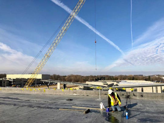 Work is being done on the new gym roof at the new Silver Spring Intermediate School in Sussex Jan. 11.