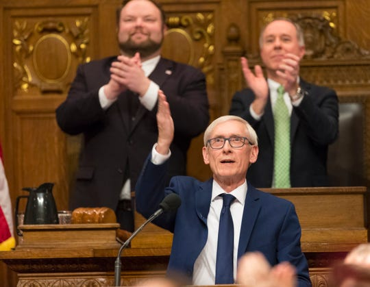 Gov. Tony Evers blows a kiss to his wife, Kathy, before delivering his State of the State address at the Capitol in Madison on Tuesday night.