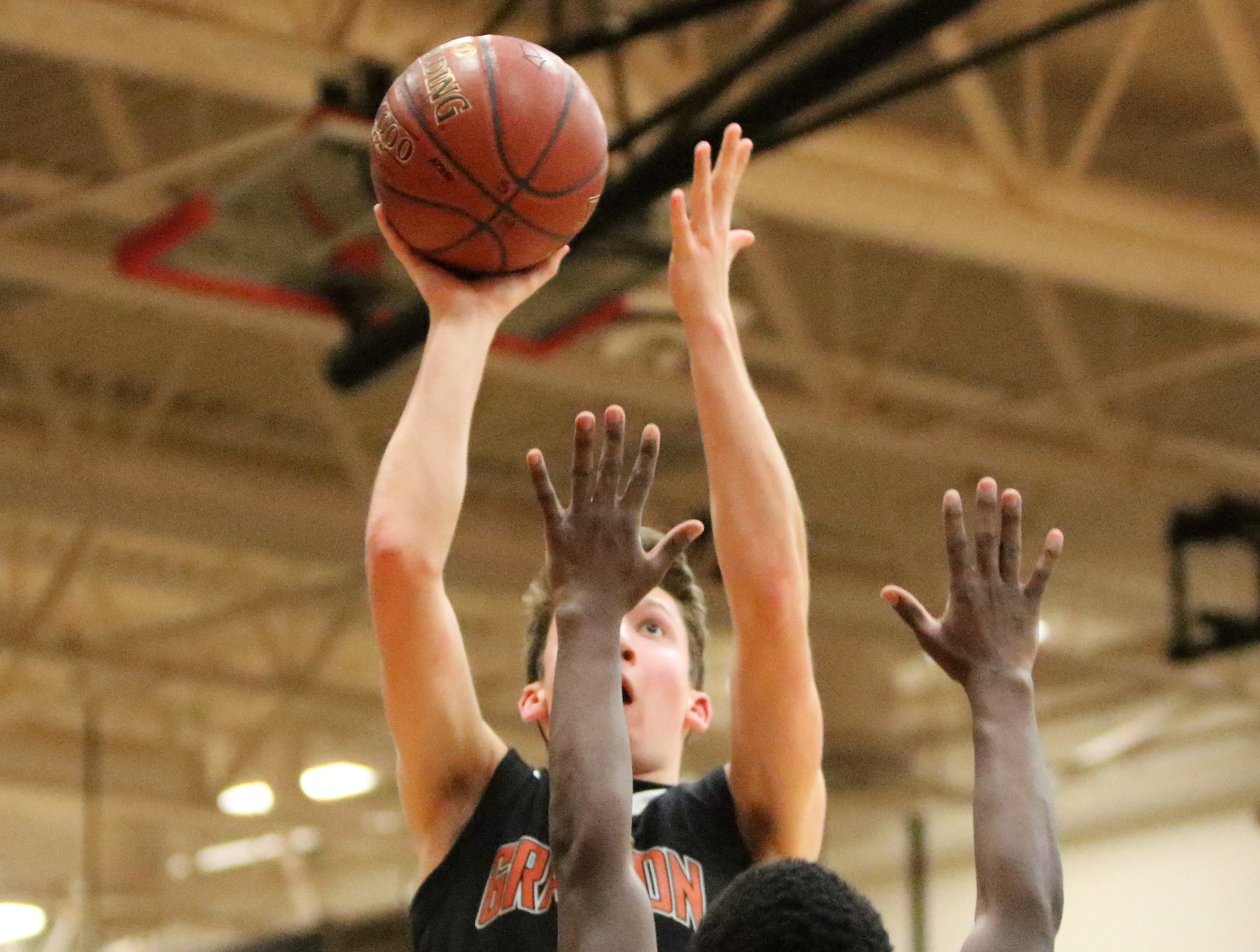Grafton guard Jaden Polack rises up for a floater against South Milwaukee on Jan. 22, 2019.