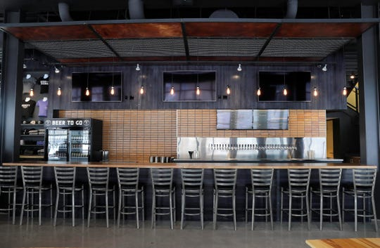 The front bar at Good City Brewing downtown offers a fan setting with 32 taps of beer and a grab-and-go food section at the end of the bar.
