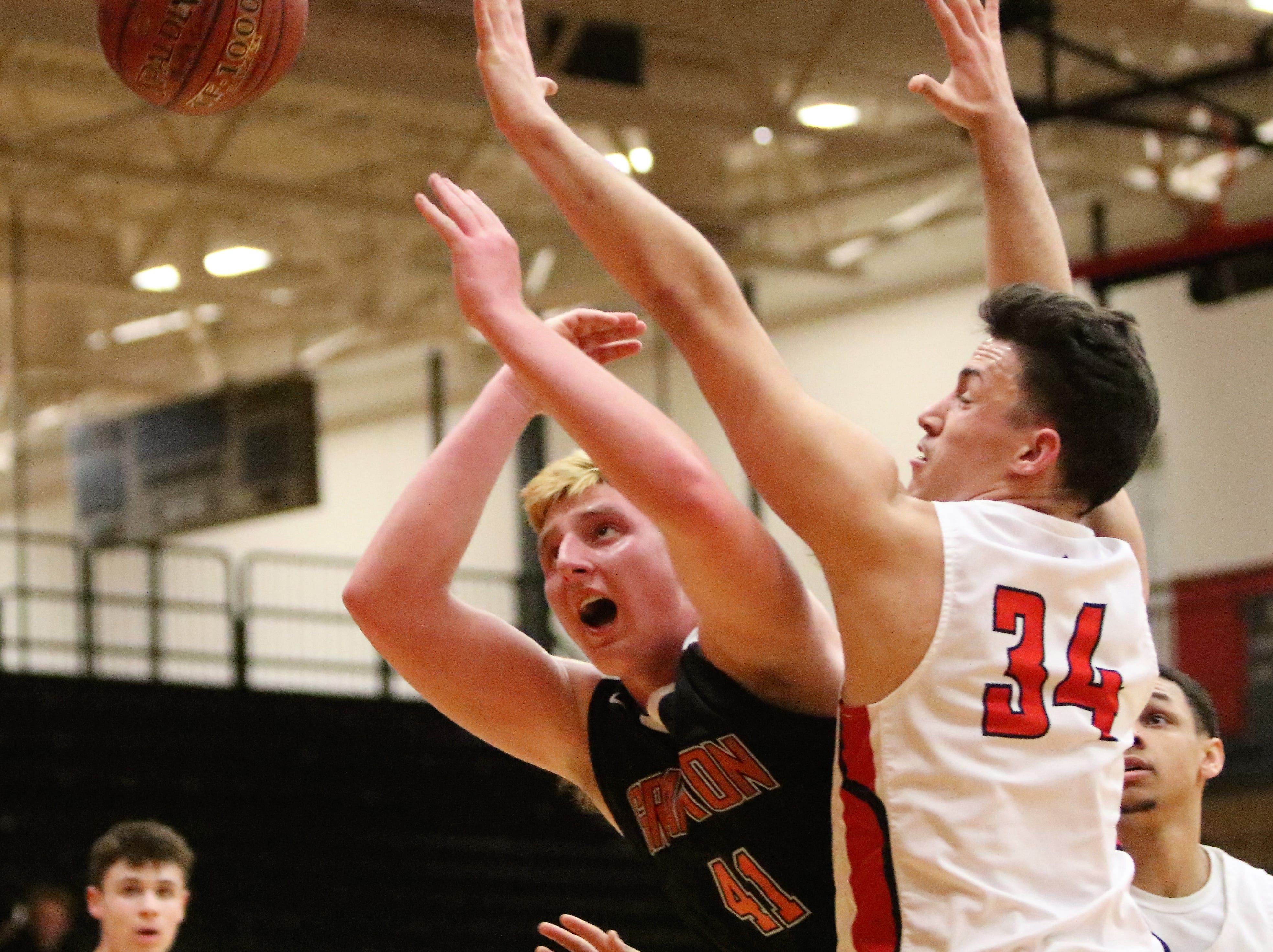 Grafton forward JP Benzschawel loses the ball while going up for a shot against the defense of South Milwaukee forward Luis Ortiz on Jan. 22, 2019.