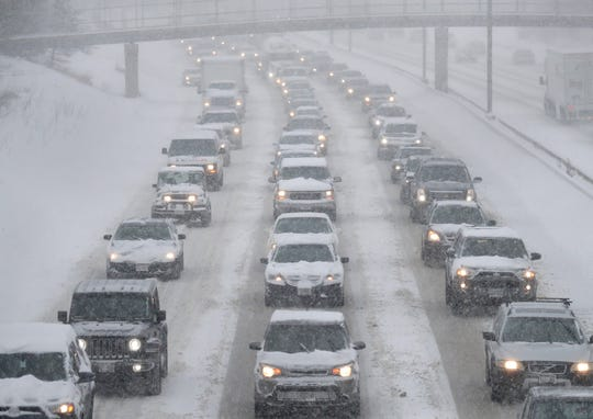 Traffic is backed up in the snow on I-43 southbound near East Locust Street in Milwaukee.