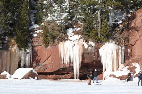 Rustic Makwa Den offers tours of ice-covered sea caves near Red Cliff on the Bayfield peninsula.
