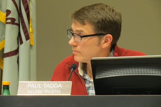 At a January 21 meeting, village trustee Paul Tadda listens to his fellow board members provide feedback on his and Jeremy Walz's proposals.