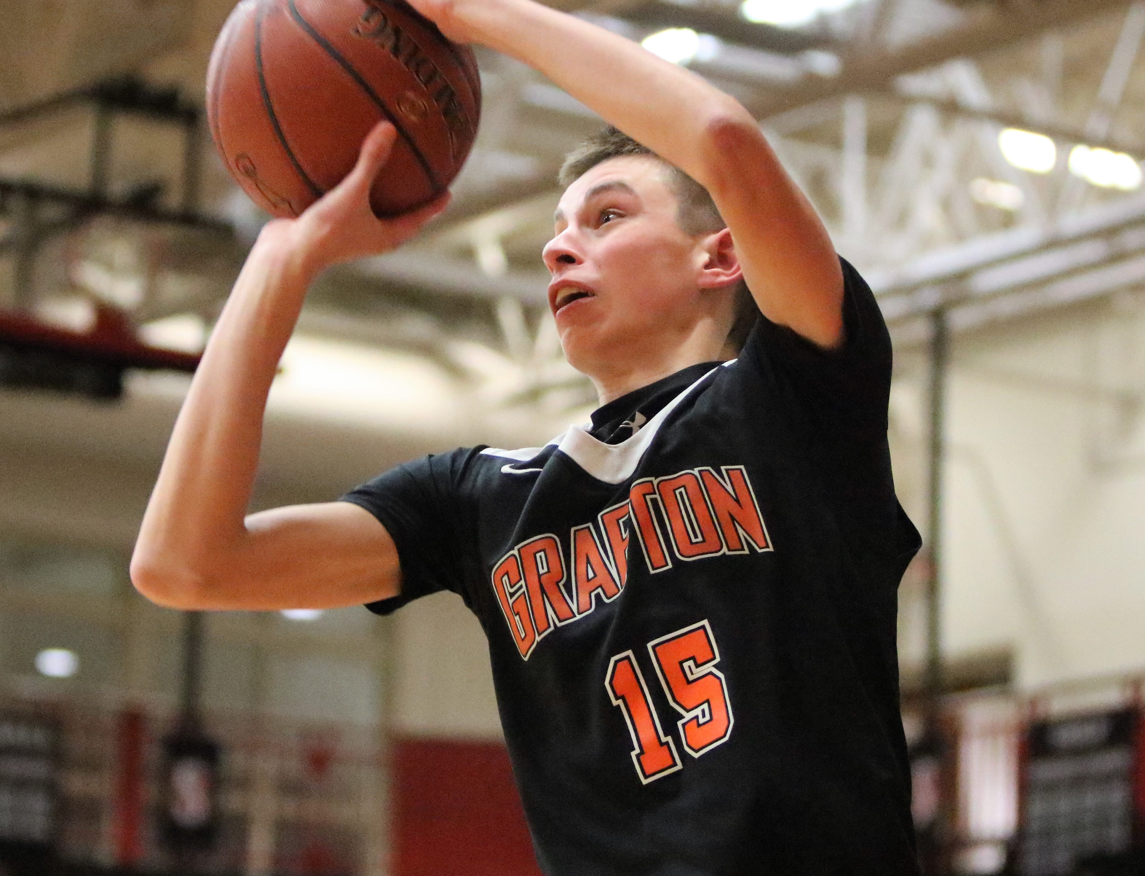 Grafton guard Jacob Aleknavicius lines up a three-pointer in a game against South Milwaukee on Jan. 22, 2019.