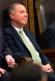 Assembly Speaker Robin Vos listens to Gov. Tony Evers deliver his State of the State address at the Capitol.