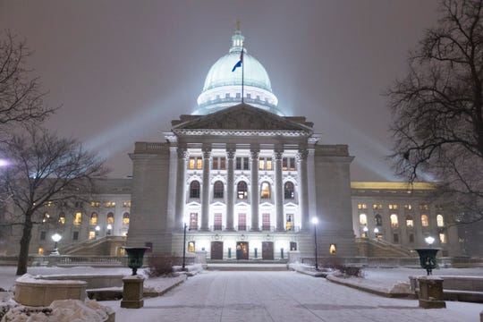 The Capitol is shown as light snow falls before Gov. Tony Evers delivers his State of the State address in Madison.