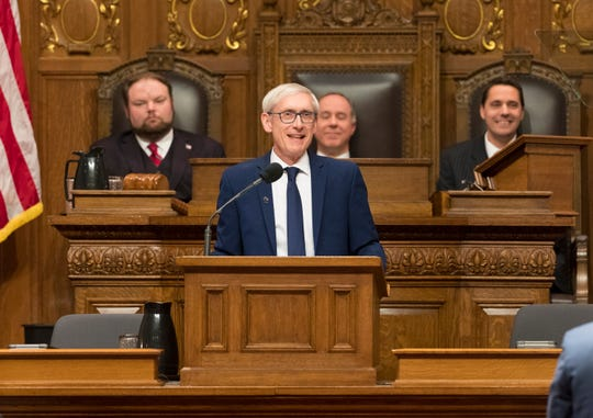 Gov. Tony Evers delivers his State of the State address at the Capitol in Madison on Tuesday night.