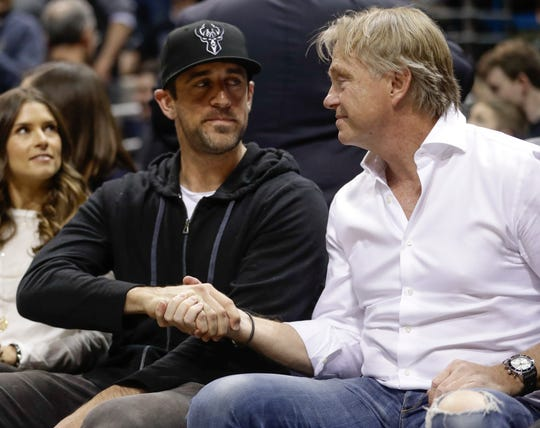 Packers quarterback Aaron Rodgers and Bucks co-owner Wes Edens take in a 2018 NBA playoff game. Rodgers became a 1 percent investor in the team before last season.