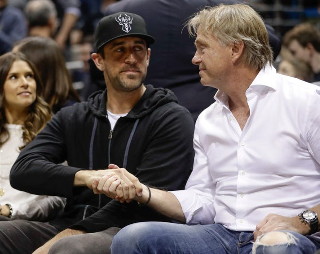Bucks co-owner Wes Edens (right) and Green Bay Packers quarterback and Bucks minority owner Aaron Rodgers watch the first half of a Milwaukee-Boston playoff game last year.