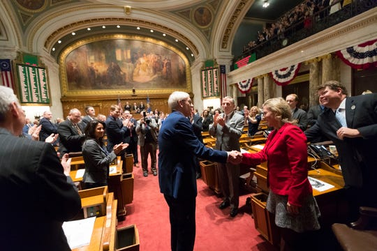 Gov. Tony Evers enters the Assembly to deliver his State of the State address at the Capitol in Madison on Tuesday night.