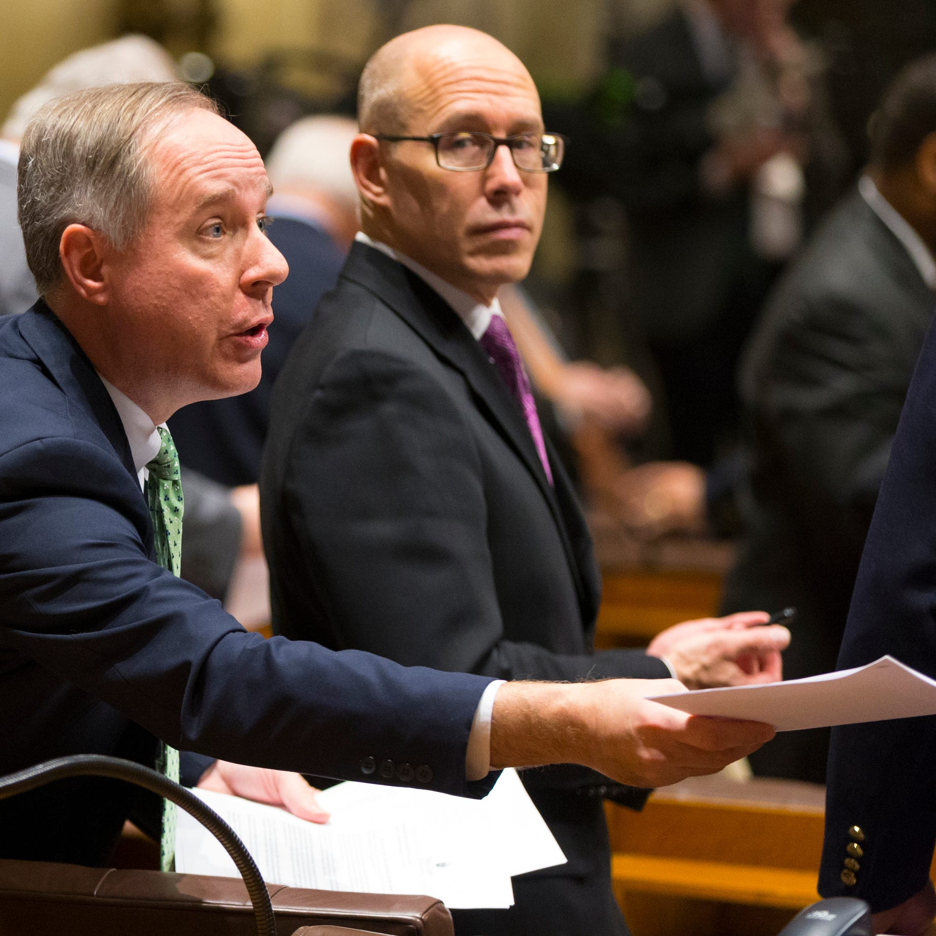 Assembly Speaker Robin Vos hands out copies of Gov. Tony Evers' State of the State address at the Capitol in Madison on Tuesday night.