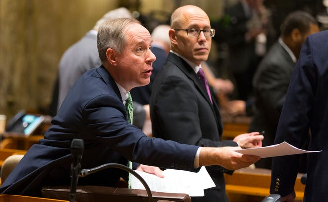 Assembly Speaker Robin Vos hands out copies of Gov. Tony Evers' State of the State address at the Capitol in Madison in February.