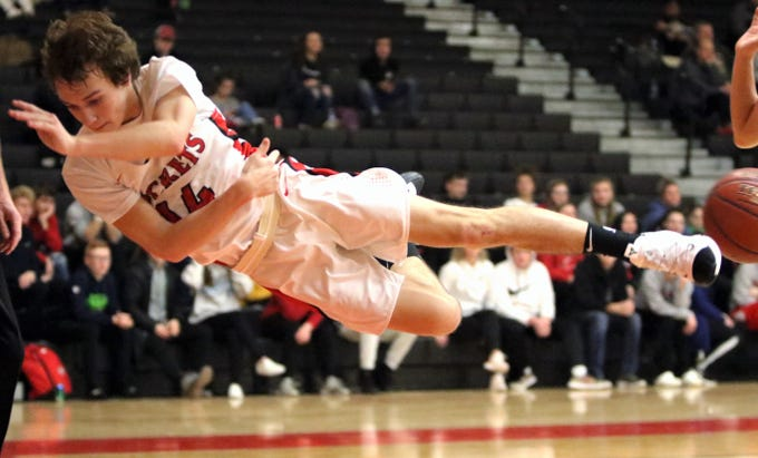 South Milwaukee guard Zach Paczocha goes airborne to save a ball from going out of bounds in a game against Grafton on Jan. 22, 2019.