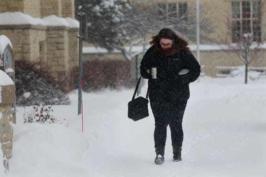 Ash Rotonto arrives at Mount Mary University in Milwaukee for the first day of class. Rotonto, who is in the art therapy program, was hoping that her class would be delayed or canceled. No such luck. She and others had to brave the snowstorm.