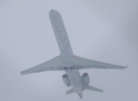 A plane takes off at Mitchell International Airport in Milwaukee on Wednesday, Jan. 23, 2019. A handful of flights were canceled or delayed at Mitchell International, but most of the flights appeared to be arriving or departing near their scheduled times. A steady overnight snow covered southern Wisconsin with several inches of snow, but the National Weather Service is saying the worst of the storm will hit the area between 5 and 11 a.m., making for a very challenging morning commute. Photo by Mike De Sisti / Milwaukee Journal Sentinel