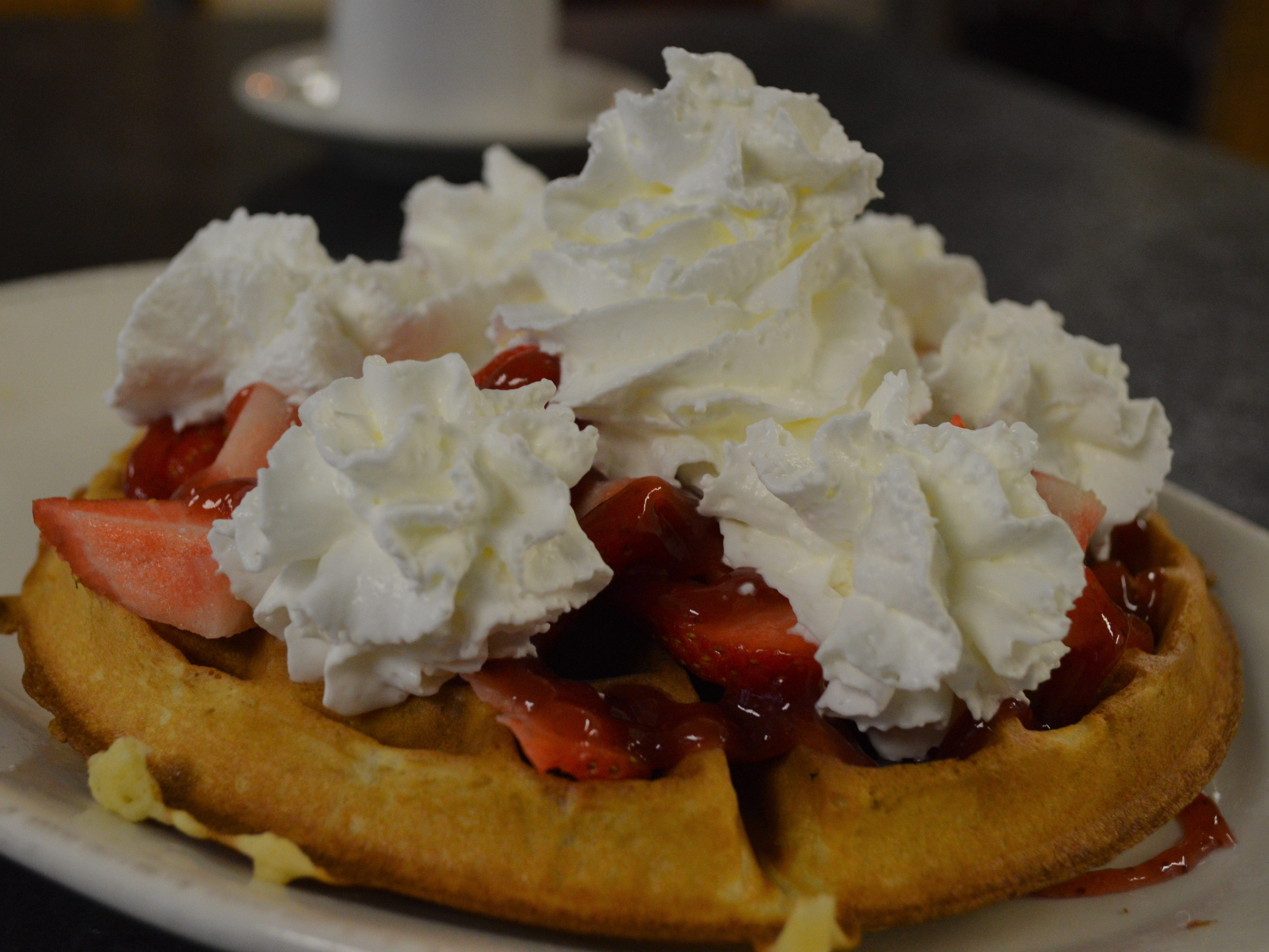 A fresh fruit waffle with whipped cream costs $8.95. The cafe has fresh strawberries, blueberries and bananas.