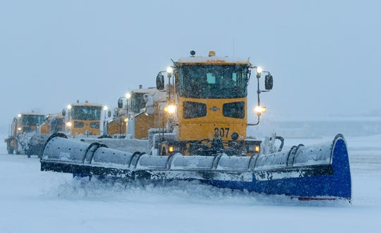 Snow removal at Mitchell International Airport takes place when accumulations reach an amount that's hazardous for take off and landing. FAA requires that as soon as 1 inch or more of snow is on a runway, it has to be cleared. Crews have 20-30 minutes to clear 410 acres of pavement at the airport.