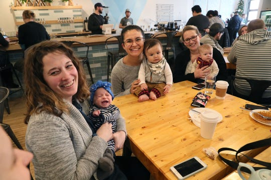 A group of new moms and friends meets up at Vennture Brewing, a brewery/coffee shop at 5519 W. North Ave. (That's coffee, not beer, on the table.) From left: Maggie Moss of Milwaukee, holding daughter Lucia Cortes-Moss (age 2 months); Paula Phillips of Milwaukee, holding her son Nathaniel Phillips Riemer (6 months) and Janice Anderson of Wauwatosa, holding daughter Abigail Anderson (3 months).