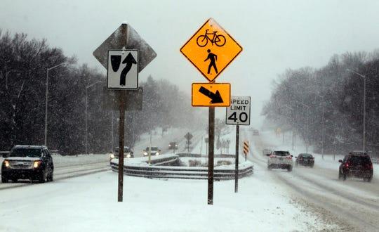 Slushy roads make for careful driving Wednesday on Mayfair Road near Capitol Drive in Wauwatosa.
