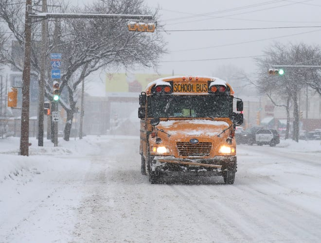 A school bus heads down West Atkinson Avenue in Milwaukee on Wednesday.