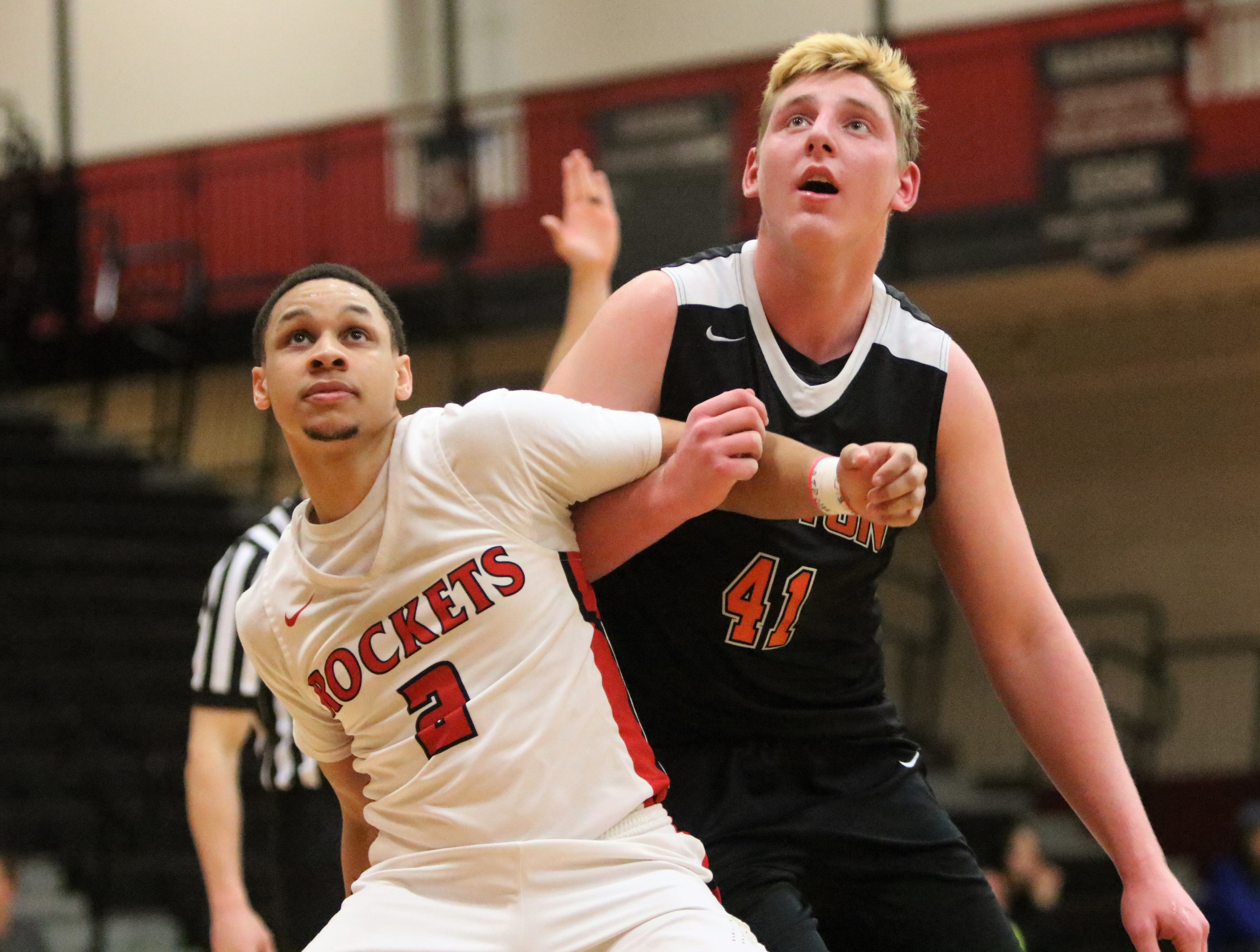 South Milwaukee forward Dez Fitzpatrick (left) boxes out Grafton forward JP Benzschawel during a game on Jan. 22, 2019.