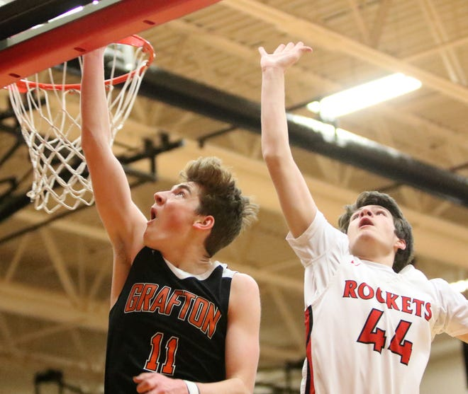 Grafton guard Alex Huibregtse gets a layup off the glass before South Milwaukee forward Alex Brion can come in for the block on Jan. 22, 2019.