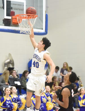 Mountain Home's Luke Kruse goes up for two against Searcy on Tuesday night.