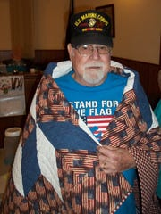 Larry Vossof Mountain Home, was recently awarded a Quilt of Valor by Mountain Home Quilts of Valor.Voss served in the U.S. Marine Corps from 1953-1968, with servicein Vietnam.He was in Reconnaissanceand received the Purple Heart with one star.The ceremony was held at the Mountain Home American Legion Post 52 and attended by fellow veterans, family and friends.