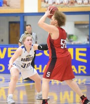 Mountain Home's Addison Yates defends Searcy's Ta'lor Branch on Tuesday night.
