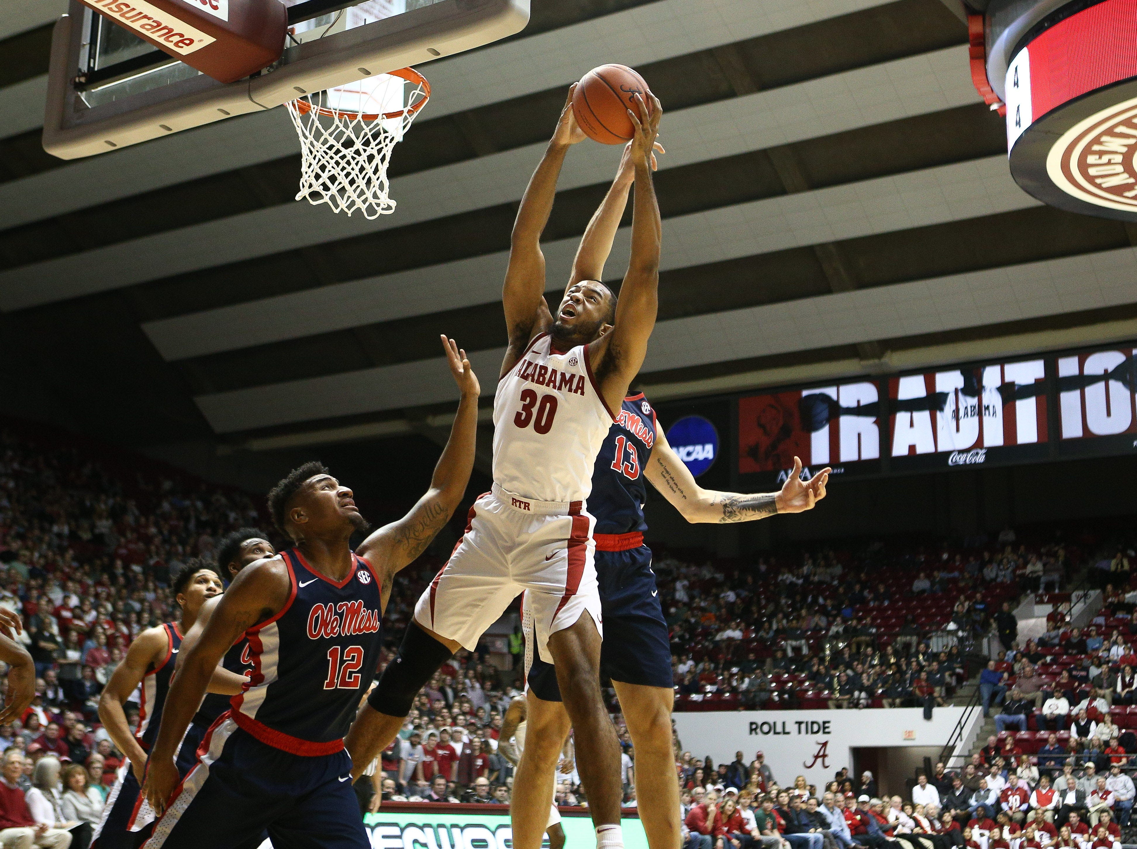 Jan 22, 2019; Tuscaloosa, AL, USA; Alabama Crimson Tide forward Galin Smith (30) pulls down a rebound against Mississippi Rebels center Dominik Olejniczak (13) during the second half at Coleman Coliseum. Mandatory Credit: Marvin Gentry-USA TODAY Sports