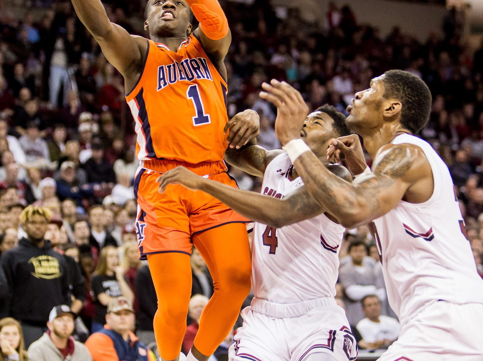 Jan 22, 2019; Columbia, SC, USA; Auburn Tigers guard Jared Harper (1) shoots over South Carolina Gamecocks guard Tre Campbell (4) and forward Chris Silva (30) in the second half at Colonial Life Arena. South Carolina won 80-77. Mandatory Credit: Jeff Blake-USA TODAY Sports