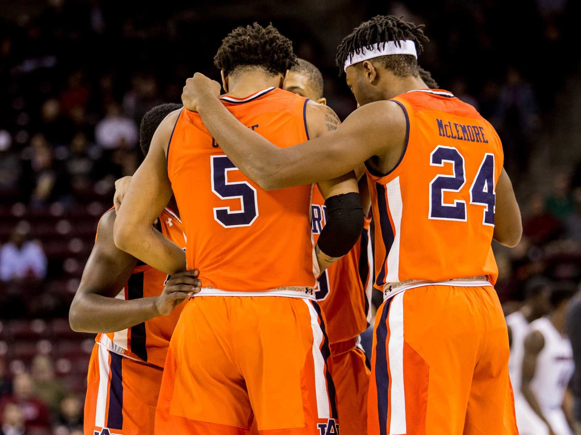 Auburn players huddle before their game against the South Carolina Gamecocks at Colonial Life Arena.