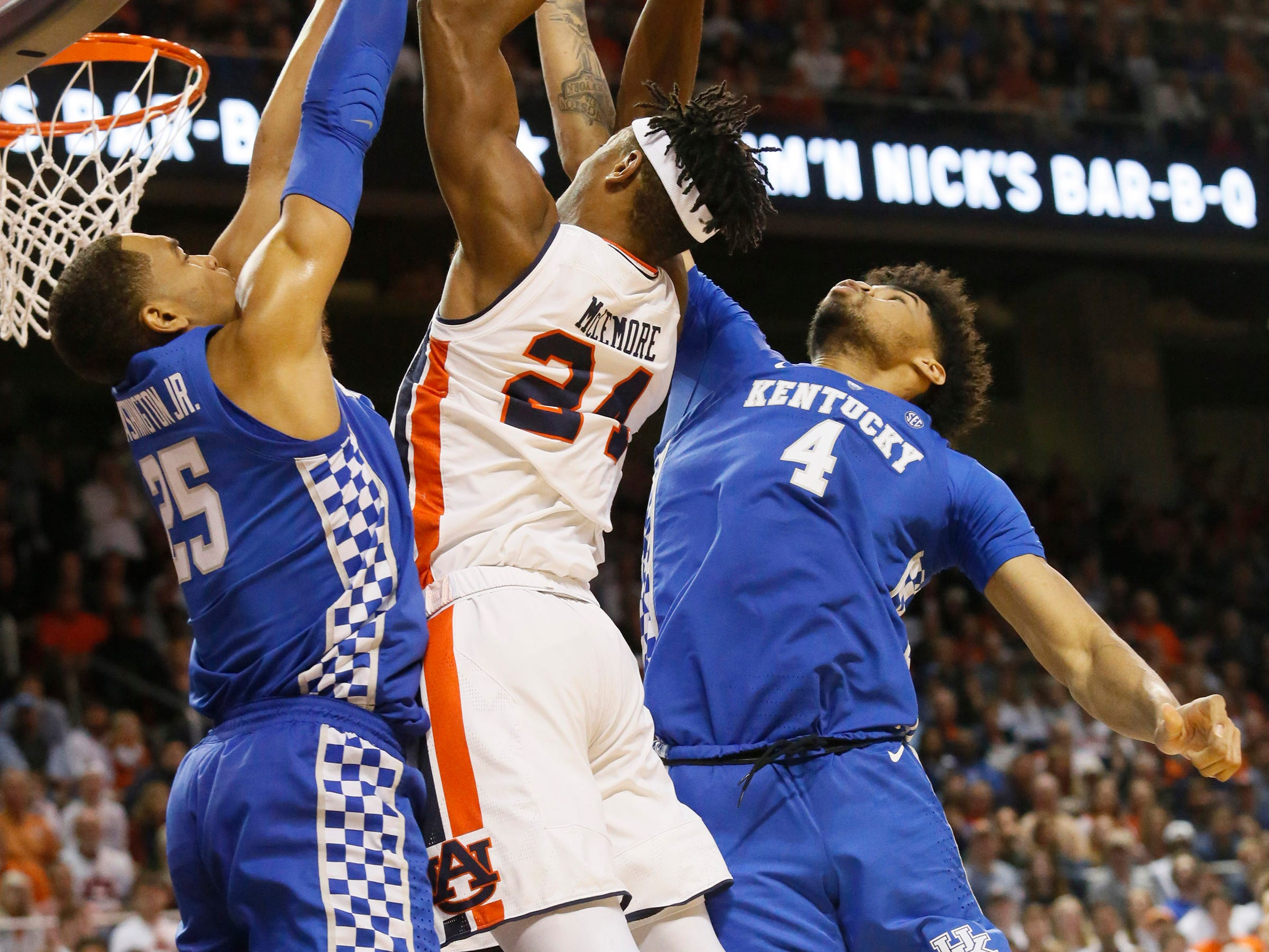 Jan 19, 2019; Auburn, AL, USA;  Kentucky Wildcats forwards PJ Washington (25) and Nick Richards (4) block Auburn Tigers forward Anfernee McLemore (24) during the second half at Auburn Arena. Mandatory Credit: John Reed-USA TODAY Sports