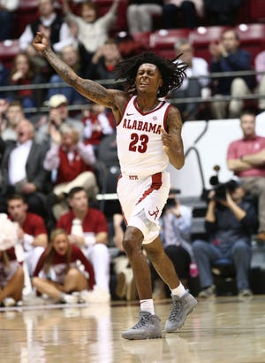 Jan 22, 2019; Tuscaloosa, AL, USA; Alabama Crimson Tide guard John Petty (23) reacts after hitting a 3 pointer against Mississippi Rebels during the first half at Coleman Coliseum. Mandatory Credit: Marvin Gentry-USA TODAY Sports
