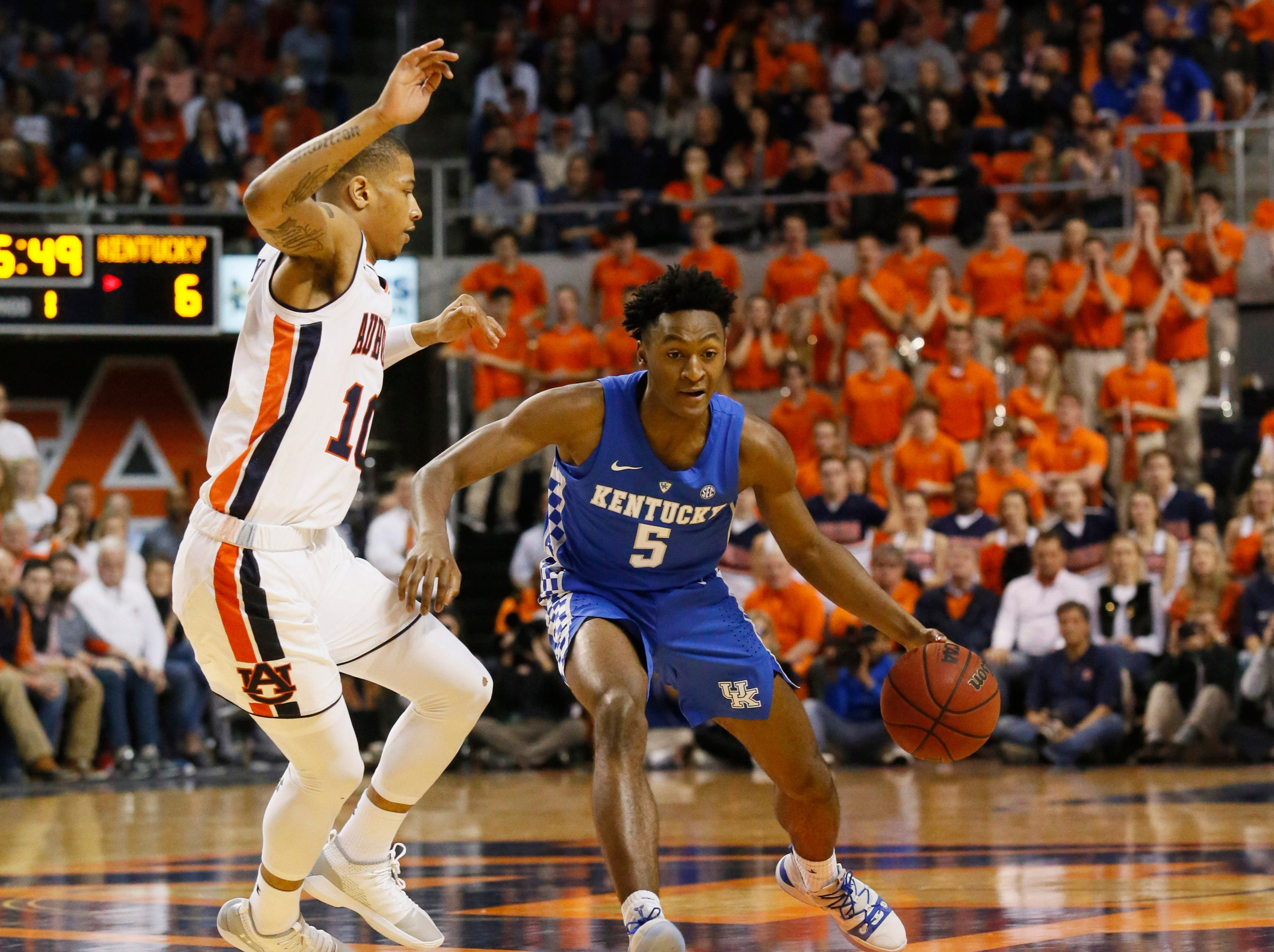 Jan 19, 2019; Auburn, AL, USA; Kentucky Wildcats guard Immanuel Quickley (5) is pressured by Auburn Tigers guard Samir Doughty (10) during the first half at Auburn Arena. Mandatory Credit: John Reed-USA TODAY Sports