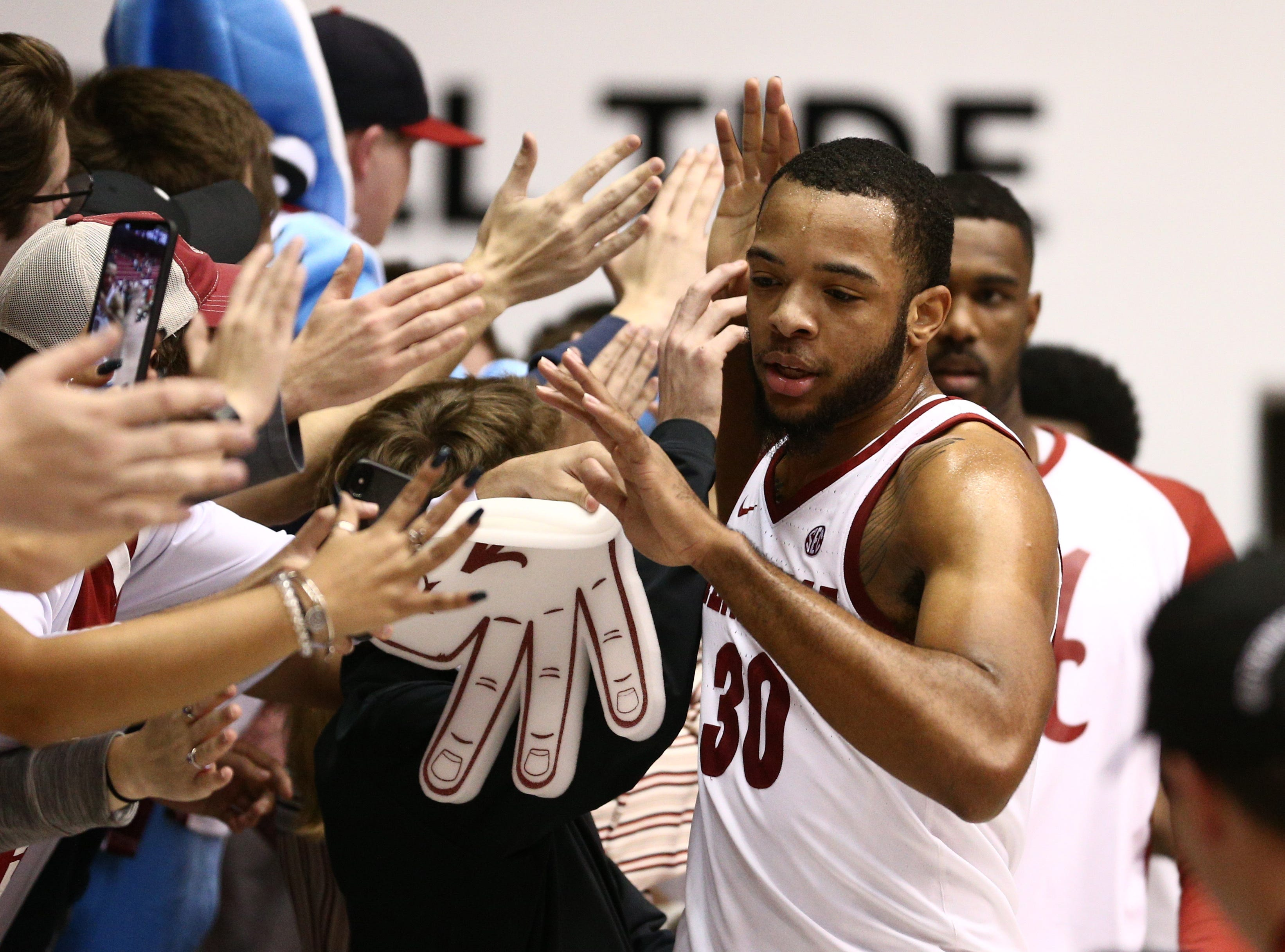 Jan 22, 2019; Tuscaloosa, AL, USA; Alabama Crimson Tide forward Galin Smith (30) celebrates with fans after defeating the Mississippi Rebels at Coleman Coliseum. Mandatory Credit: Marvin Gentry-USA TODAY Sports