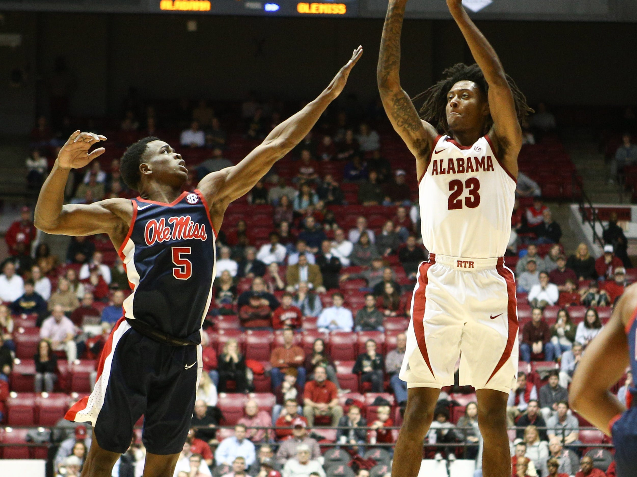 Jan 22, 2019; Tuscaloosa, AL, USA; Alabama Crimson Tide guard John Petty (23) shoots against Mississippi Rebels guard Brian Halums (5) during the second half at Coleman Coliseum. Mandatory Credit: Marvin Gentry-USA TODAY Sports