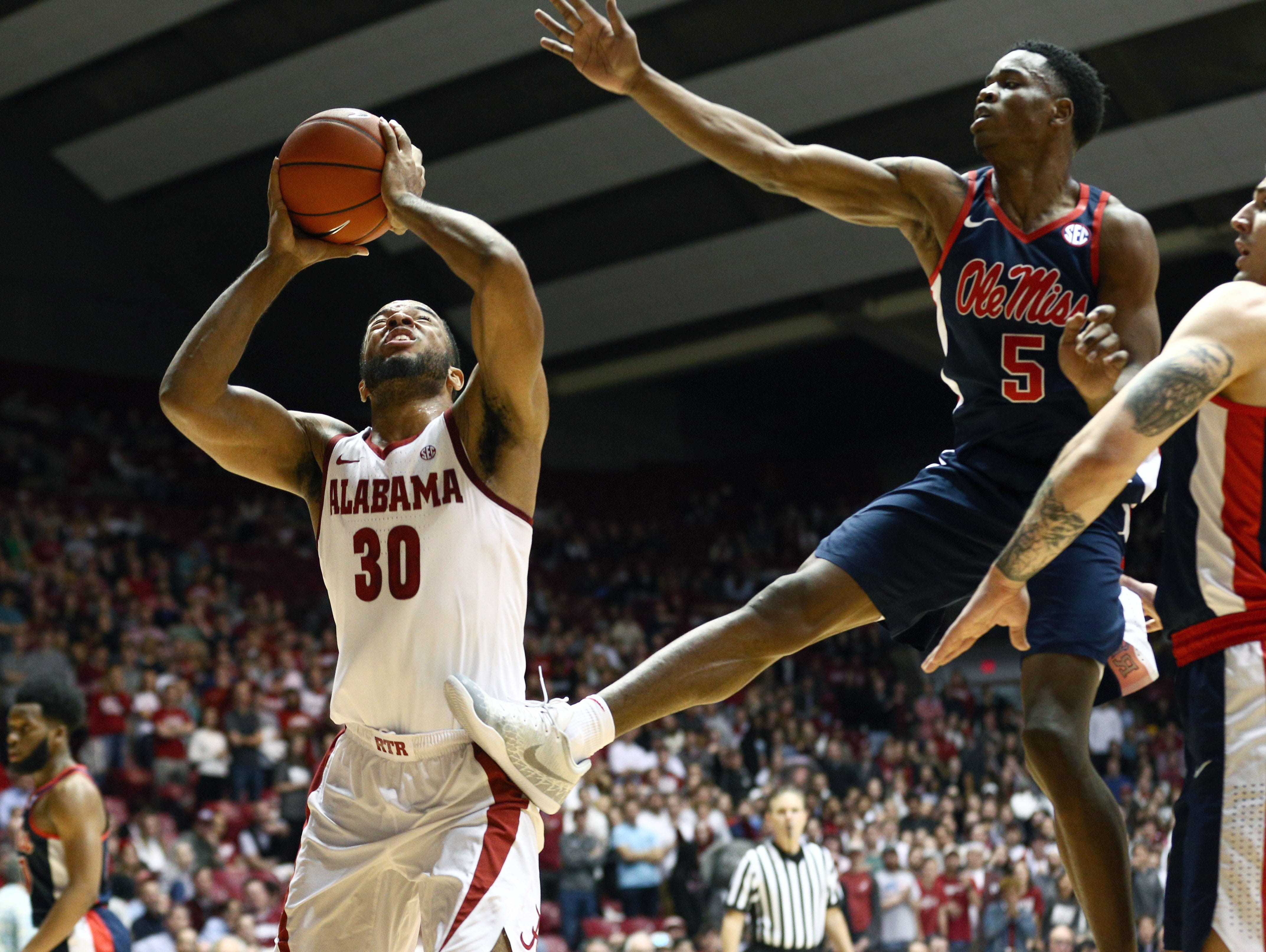 Jan 22, 2019; Tuscaloosa, AL, USA; Alabama Crimson Tide forward Galin Smith (30) drives to the basket against Mississippi Rebels guard Brian Halums (5) during the second half at Coleman Coliseum. Mandatory Credit: Marvin Gentry-USA TODAY Sports