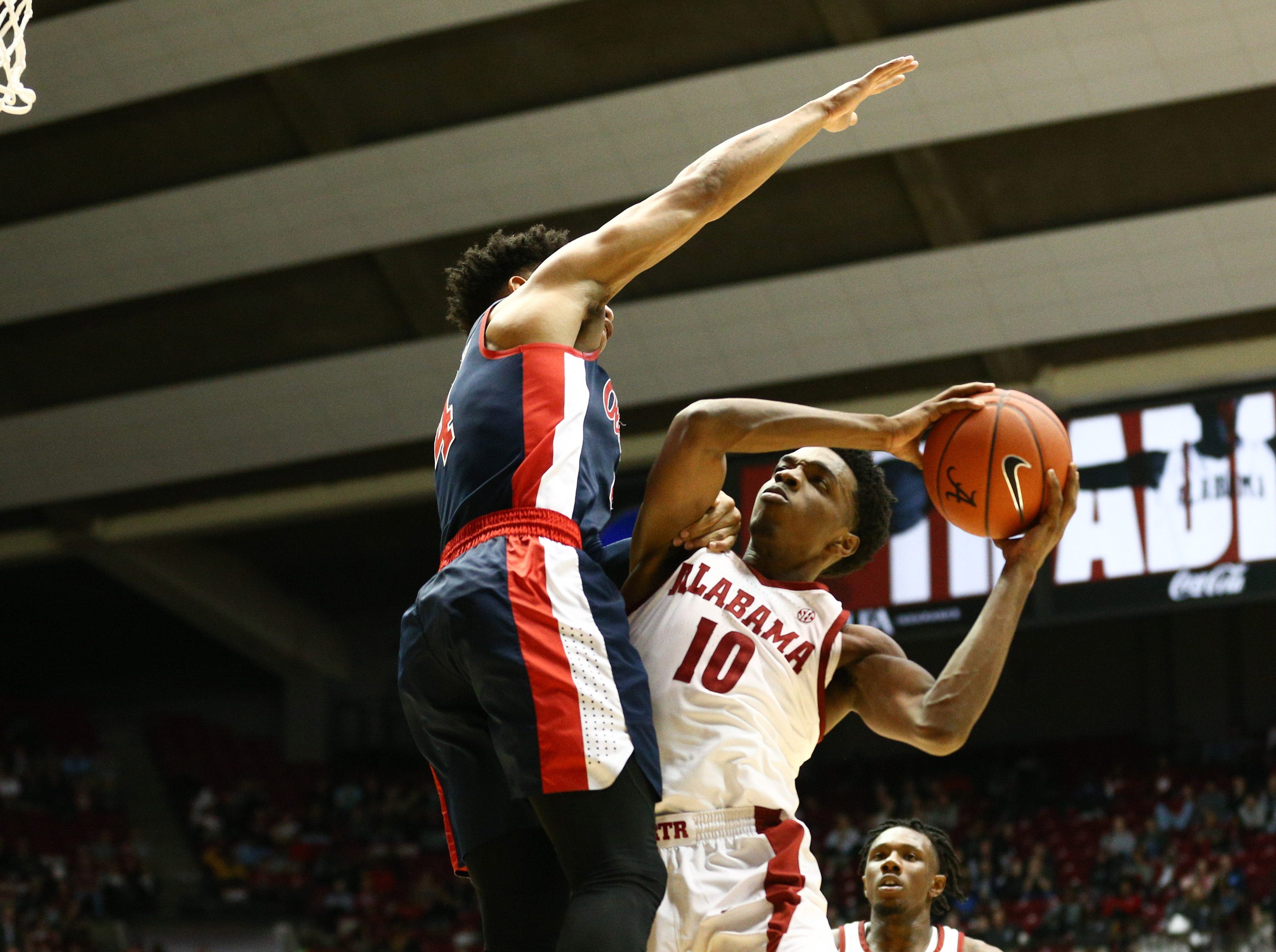 Jan 22, 2019; Tuscaloosa, AL, USA; Alabama Crimson Tide guard Herbert Jones (10) drives to the basket against Mississippi Rebels guard Breein Tyree (4) during the second half at Coleman Coliseum. Mandatory Credit: Marvin Gentry-USA TODAY Sports