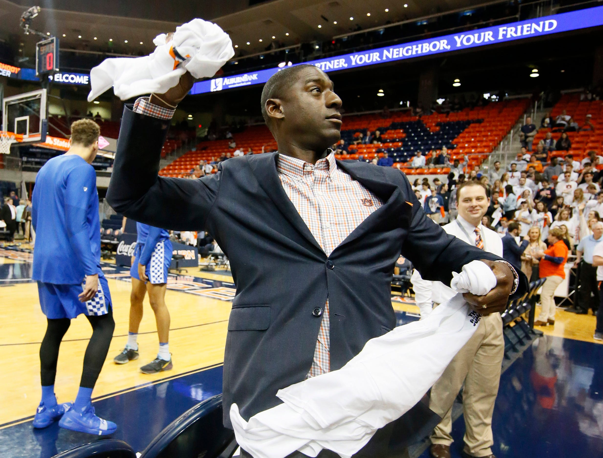 Jan 19, 2019; Auburn, AL, USA; Auburn Tigers athletic director Allen Greene throws t-shirts to the student section before the game against the Kentucky Wildcats at Auburn Arena. Mandatory Credit: John Reed-USA TODAY Sports